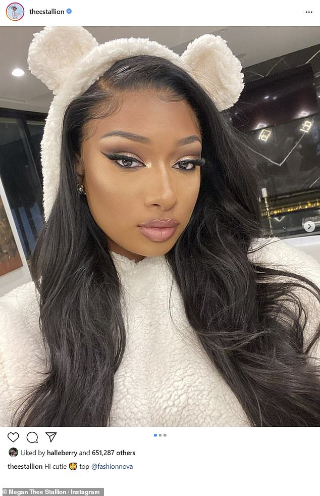 The Savage rapper struck several poses in a white furry ensemble that included a hood with ears, as she referencedher collaboration with retail fashion company, Fashion Nova