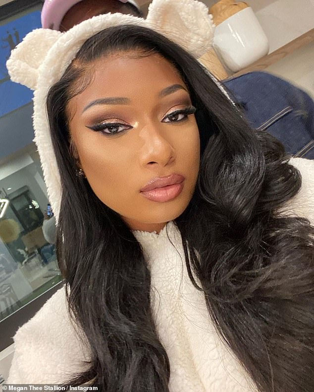 Flirty: Megan Thee Stallion shared a series of selfie photos on Saturday, one day after she made her romance withPardison Fontaine Instagram official