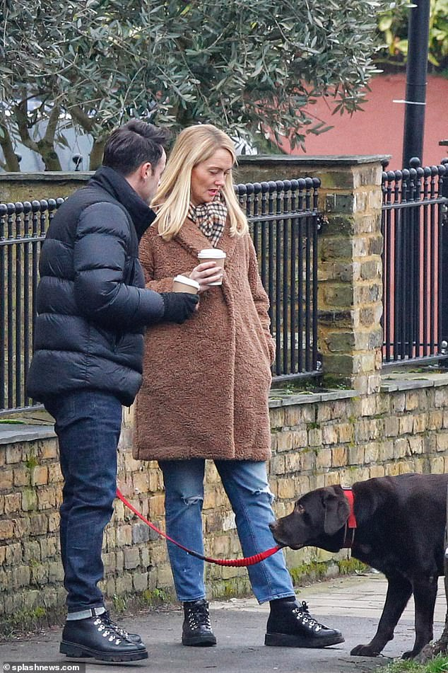 Snap! The betrothed duo stepped out in matching walking boots, identical in style and colour
