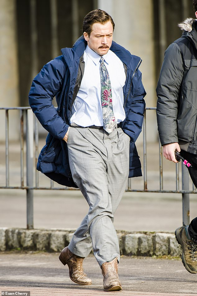 On location: Taron Egerton cut a dapper figure as he filmed scenes for the upcoming film in Aberdeen, Scotland on Sunday
