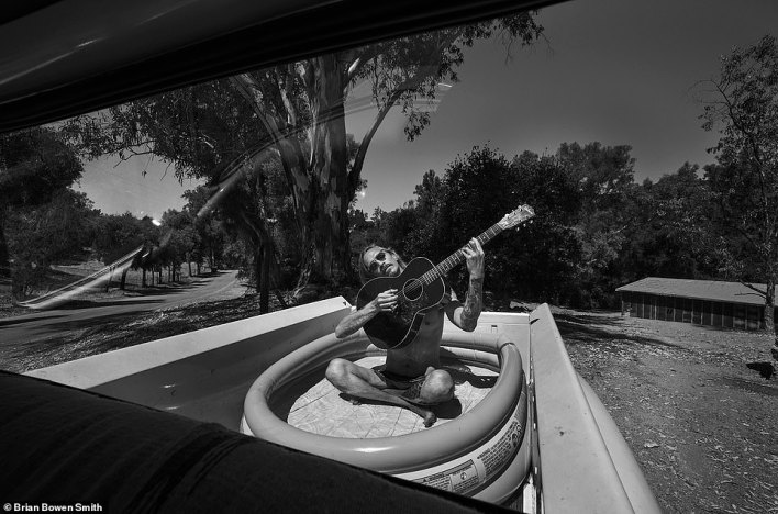 '[American singer] Brandon Boyd sitting in a pool in the back of my truck. His idea' - BBS