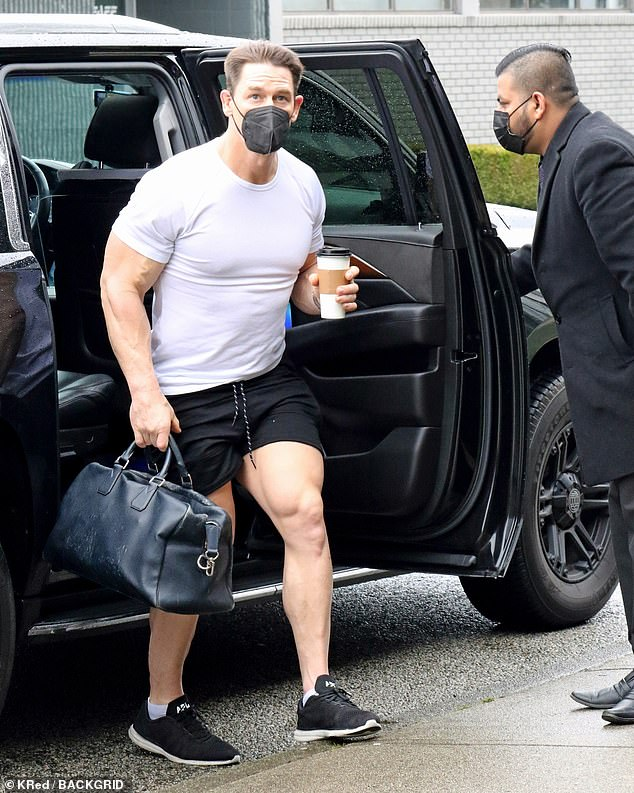 The latest:John Cena, 43, was snapped on Sunday in Vancouver, Canada, preparing for a workout as he continues production on Peacemaker, an HBO Max spinoff series of Suicide Squad
