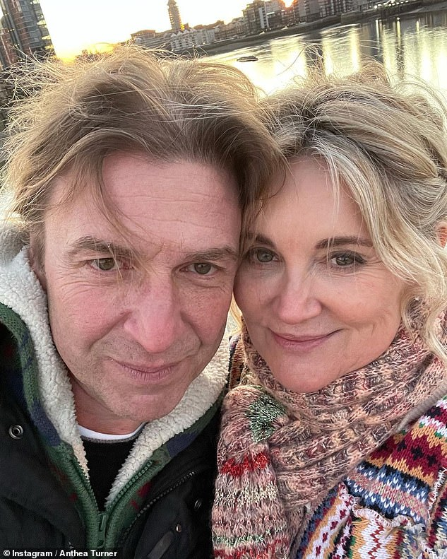 Her love: The TV presenter is engaged to herfiancé Mark Armstrong (pictured together during a walk at Christmas)