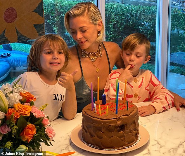 Custody battle: Newman has petitioned the court for sole physical custody of sons James, seven and Leo, five, calling his ex an 'absent parent' in court docs