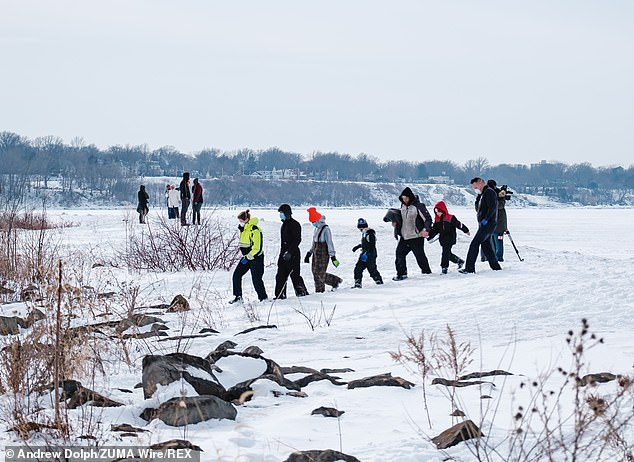People rescued off the ice of Lake Erie by members of the USCG Ice Rescue Team from Station Cleveland, as well as other local rescue agencies are seen safely escorted to shore