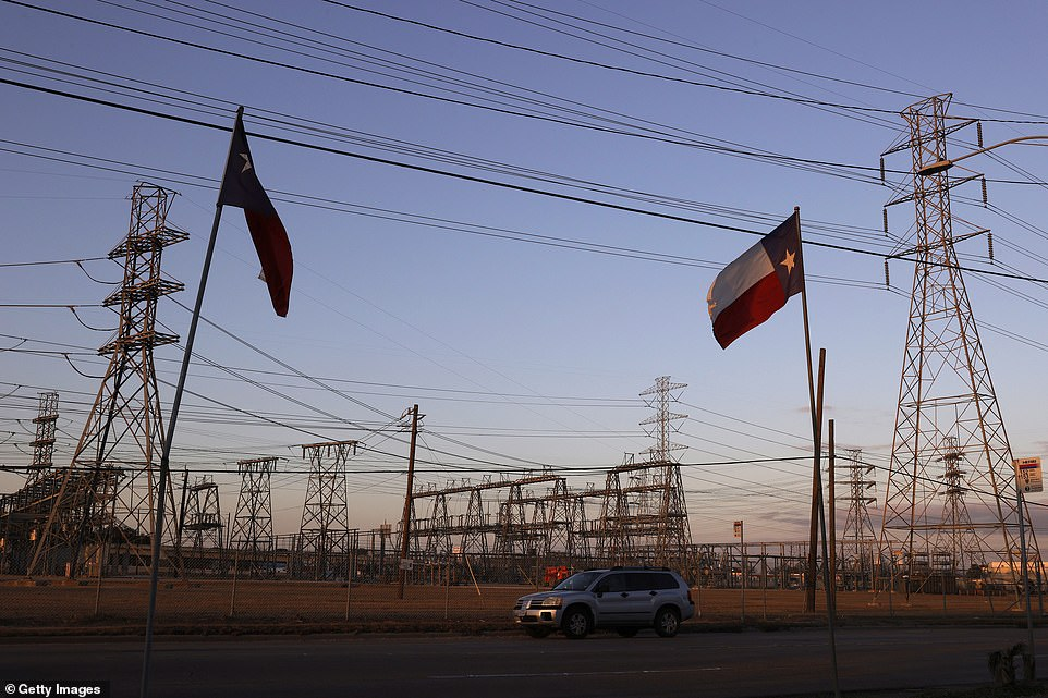 Texas flags fly near an electrical substation on Sunday in Houston, Texas. Millions of Texans lost their power when winter storm Uri hit