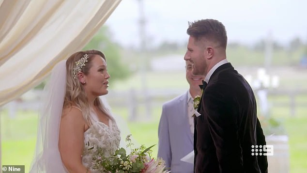 Meet cute: The newlyweds with seemingly opposite personalities couldn't get enough of each other after they met for the first time at the altar