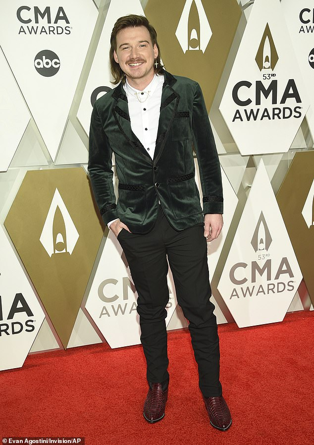 The latest:Morgan Wallen's album Dangerous: The Double Album remained at number one for the sixth week in a row on the latest Billboard 200 Sunday, on the heels of the singer taking a step back from his career amid a racism scandal. He was snapped in Nashville in 2019