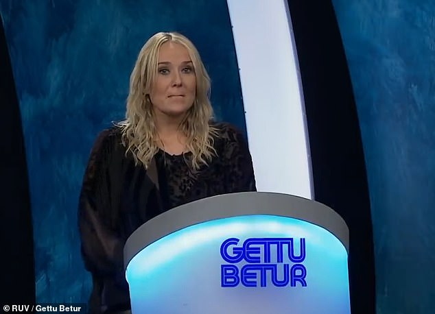 The camera cuts to host Kristjana Arnarsdóttir who looks down at her notes before trying to gallantly continue with the show