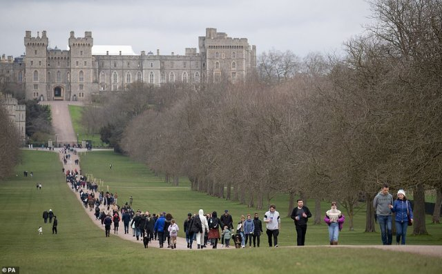 The long walk out of lockdown: People happily stroll along the Long Walk in Windsor, Berkshire today as calmer weather prevails across the south of England