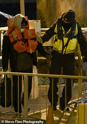 They were escorted to shore by UK Border Force and handed over to immigration officials