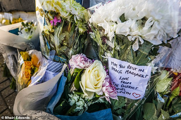 One note placed next to the flowers says 'may you rest in peace Margaret' after her death on Wednesday