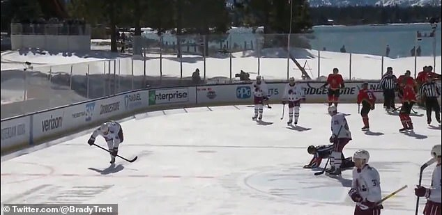 At one point during Saturday's game, bot a player (left) and ref (right) fell simultaneously