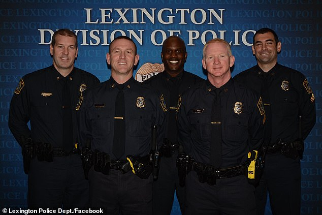 The Lexington-Fayette Urban County Council unanimously voted to fire Middleton (center) on Friday after determining that his actions put fellow officers in jeopardy