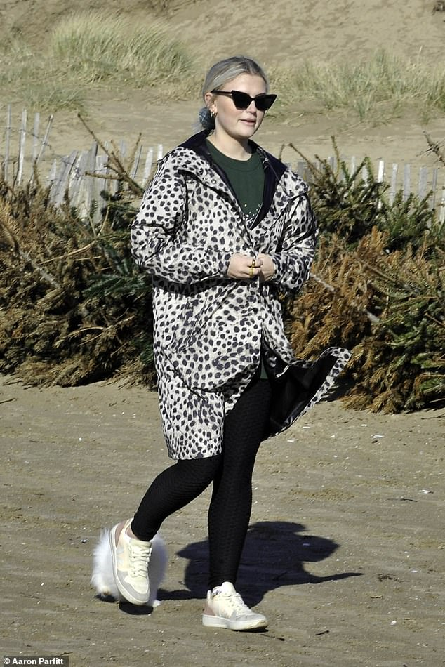 Casual: The former Coronation Street actress, 25, donned some cat eye sunglasses and the black and white jacket as she walked her pet
