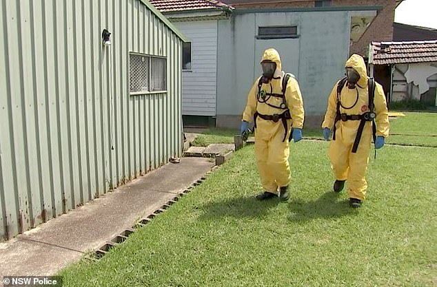 Pictured: Detectives in full protective wear searching the Western Sydney home in February