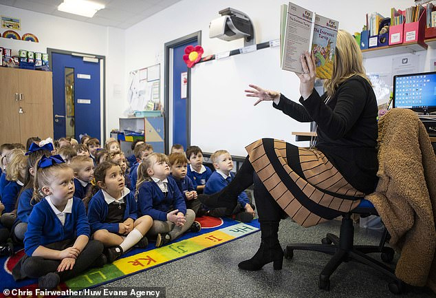 Children return to Williamstown Primary School, in Rhondda Valleys, South Wales for the first time since Christmas. All pupils aged three to seven are able to return to school full time