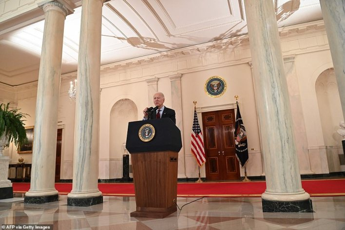 Grim total: Joe Biden spoke in the Cross Hall of the White House to pay tribute to the'extraordinary' people lost to COVID saying 'We all know someone. There is nothing ordinary about them. They spanned generations.'