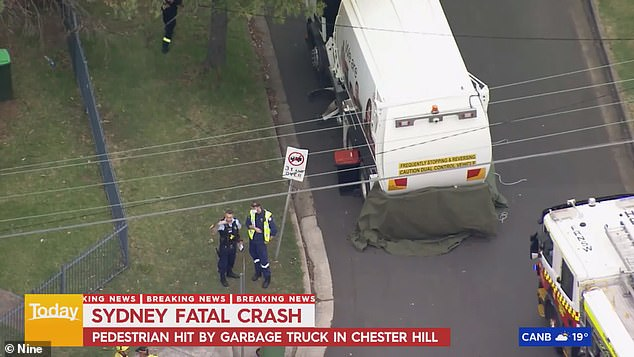 A woman has died after she was struck by a garbage truck (pictured above) in Sydney's west on Tuesday morning