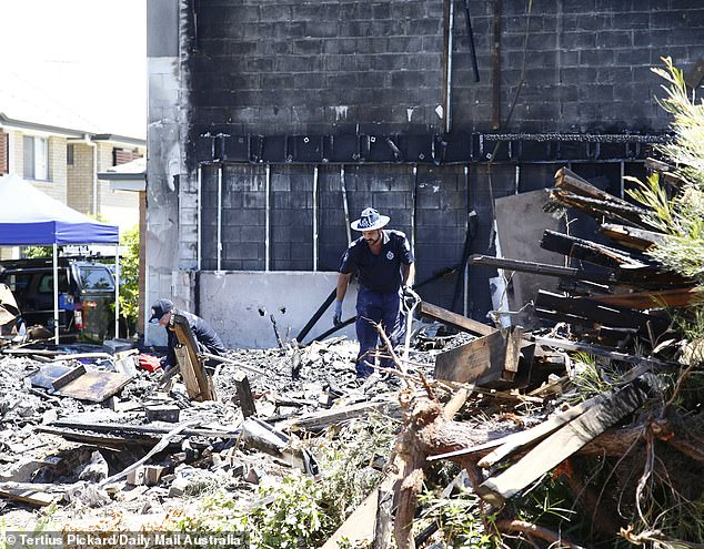 Police were pictured at the scene sifting through the rubble to attempt to piece together the events