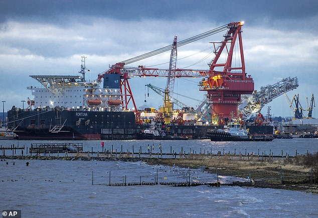 Biden has maintained criticism of Nord Stream 2, saying that it emboldens Russia and weakens leverage of vulnerable nations such as Ukraine. Tugboats get into position on the Russian pipe-laying vessel Fortuna in the port of Wismar, Germany, on January 14