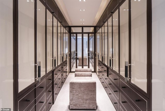 The chic dressing area of the North London home sits off the main bedroom and includes a dozen drawers in an ultra-modern design