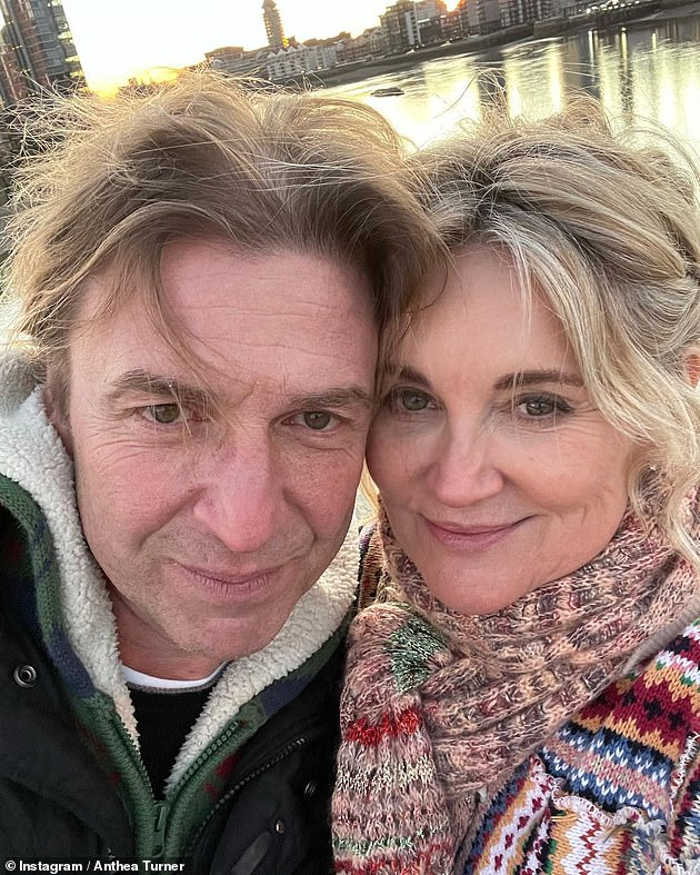 Bethrothed: The TV presenter is engaged to herfiancé Mark [pictured together during a walk at Christmas]