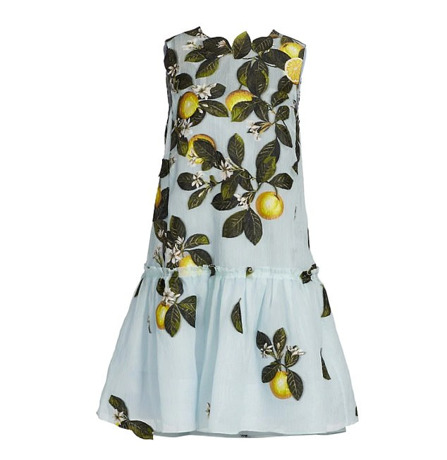 The expectant mother looked glamorous in a 60s-inspired cocktail dress, with a dramatic flounced hem and citrus fruit detailing across the bodice and skirt