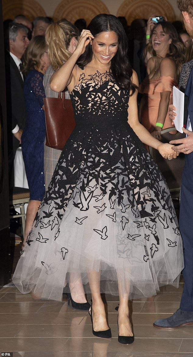 During the couple's tour of Australia in October 2018, the royal wore an exquisite Oscar de la Renta cocktail dress worth £10,000 to the Australian Geographic Society gala awards at the Shanghai-La hotel
