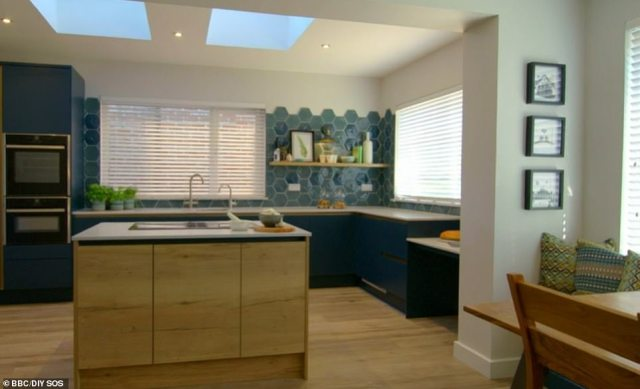 The team ripped out the old garage and built a state of the art kitchen into the area, with extra-wide spacing and a lower workspace for Mandy to join the family when cooking