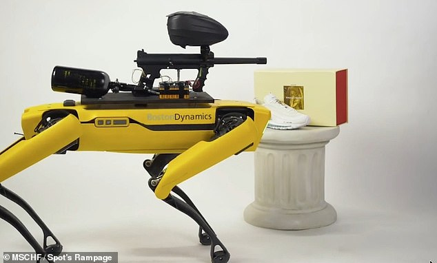 Forget 'a bull in a china shop' — tomorrow, members of the public will be able to take remote control of an armed, paintball-firing robotic dog in an art gallery, pictured