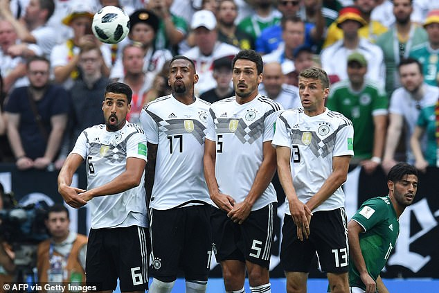 Jerome Boateng (centre left), Mats Hummels (centre right) and Thomas Muller (right) have been omitted from Low's squads since Germany's shocking 2018 World Cup exit