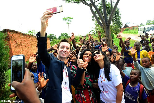 Attanasio, pictured holding a phone to take a selfie, was married and had been stationed in theDemocratic Republic of Congo for three years