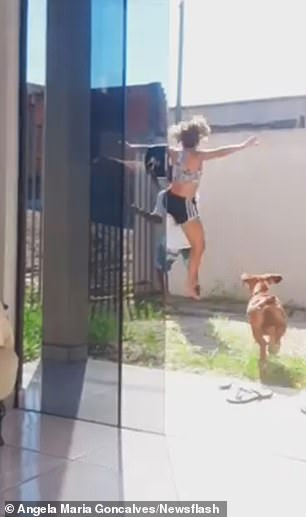 She leaps into the air and performs a mid-air karate kick on the intruder