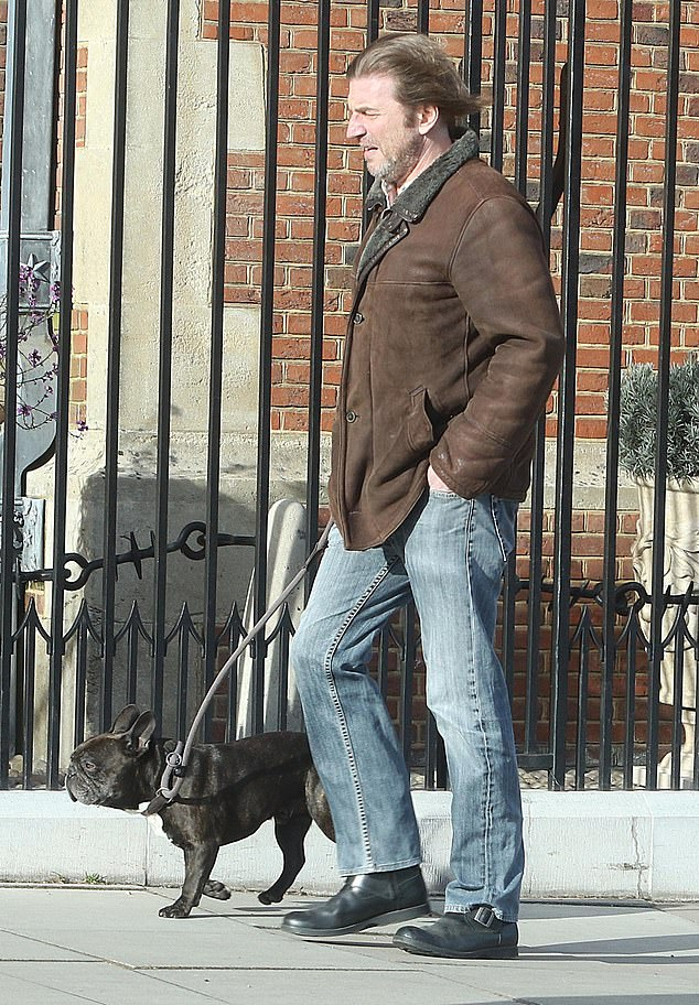 There he goes: Anthea'sfiancé Mark Armstrong meanwhile was pictured out on a dog walk