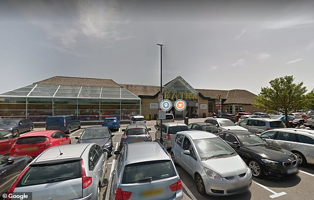 Police officers in Cambridgeshire have rescued 18 people from the back of a refrigerated lorry at Haddon Services (pictured), near Peterborough, after being contacted by the driver of the HGV