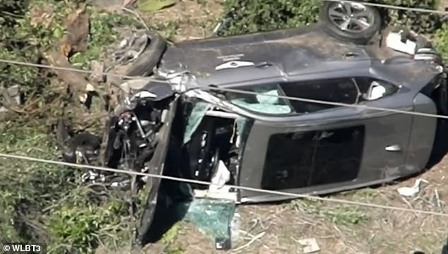 The wreckage of Woods' car on Tuesday after the crash shortly at 7am. He had to be pulled from the wreckage