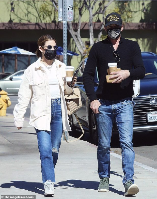 Sunny walk: after their nice brunch, the couple took their coffees to stroll down a side street