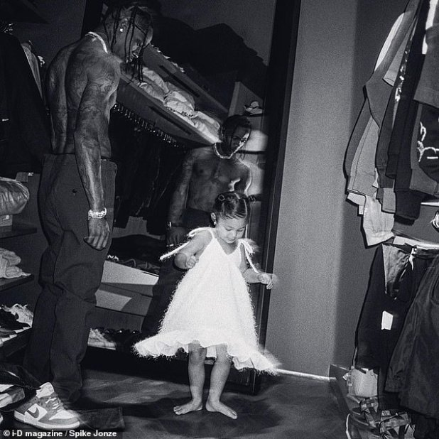 Like Mom: The 26-year-old Astroworld artist couldn't help but notice how much his little girl resembled mom Kylie Jenner as he watched her play dress-up in one shot, which he captioned: 'She looked like mommy that second.  '