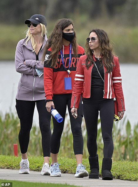 Elin Nordegren, left, Sam Alexis Woods, center, and Erica Herman follow Tiger Woods and Charlie Woods on the 11th hole during the final round of the PNC Championship golf tournament, Sunday, Dec. 20, 2020, in Orlando