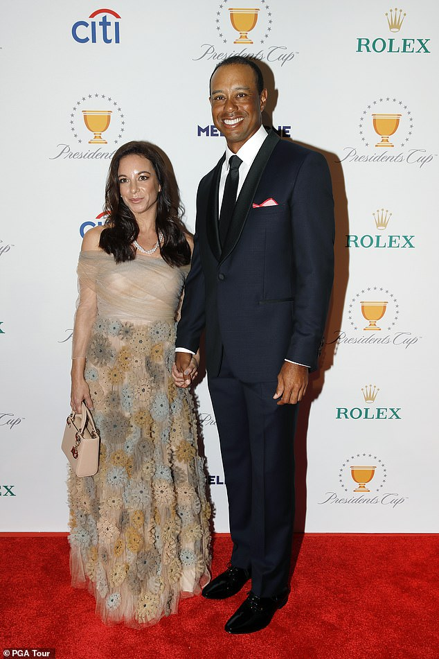 Woods is pictured with long term girlfriend Erica Herman in 2019