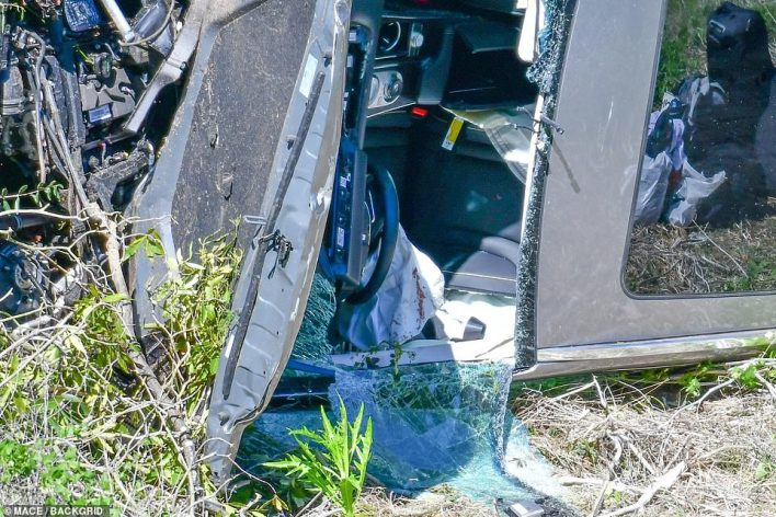 A close-up shows blood on the airbag in the drivers seat after Woods was pulled from the vehicle