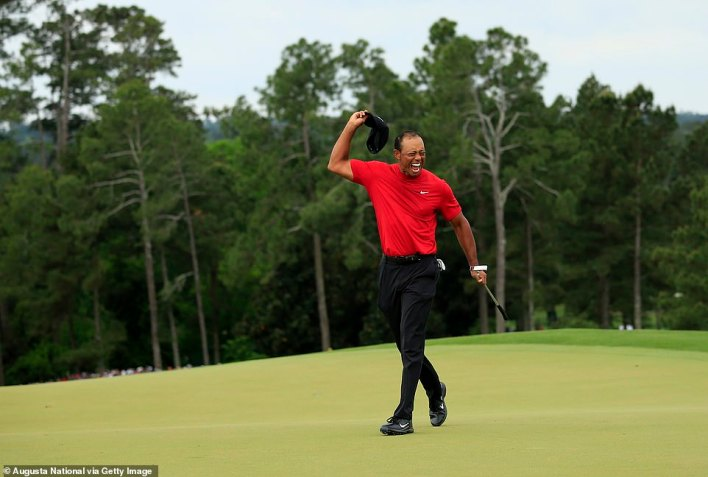 Masters champion Tiger Woods celebrates winning the Masters at Augusta National Golf Club, Sunday, April 14, 2019