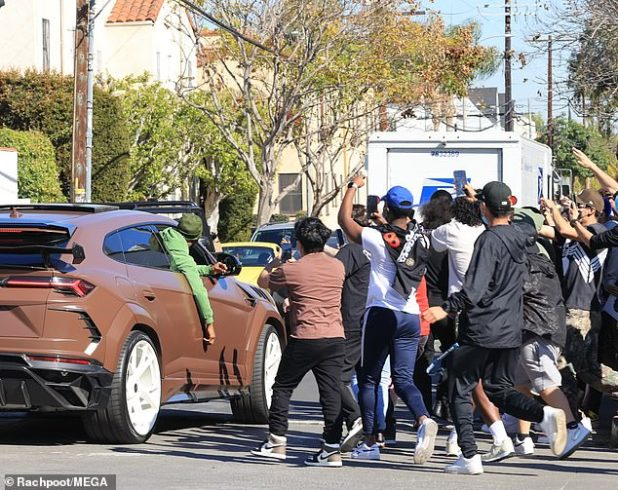 Expect us!  Fans crowded by the rapper's car