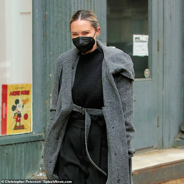 Style: The Brisbane-born beauty, who has lived in the US for nearly a decade, paired the coat with an all-black ensemble that included cropped pants and a sweater