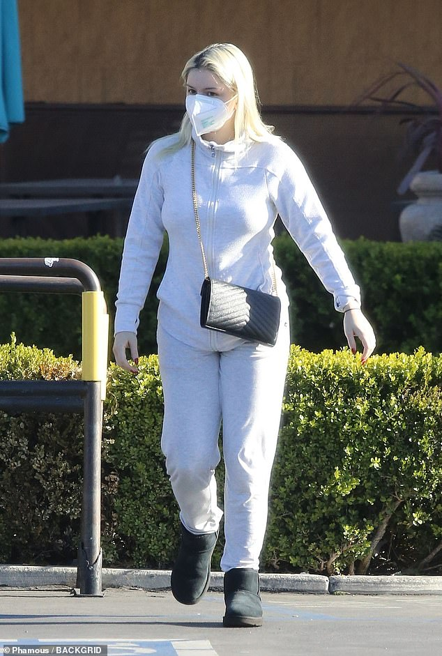 Shopping trip: Ariel Winter was unmissable in a white sweatshirt and matching joggers tucked into black boots as she ran some errands in LA on Tuesday