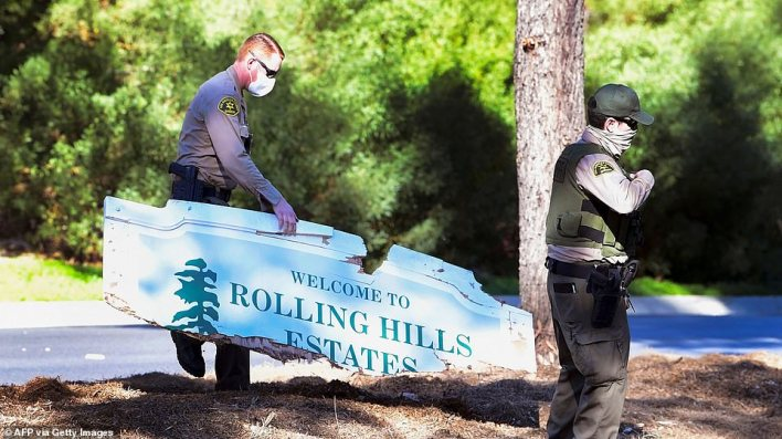 Woods' SUV smashed into the Rolling Hills Estates sign, shattering the wooden post