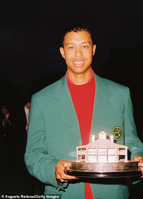 News of a serious car crash that left Tiger Woods with 'multiple leg injuries' Tuesday marked the latest chapter in 15-time major winner's turbulent life. Pictured: Masters champion Tiger Woods poses with his Masters trophy in 1997