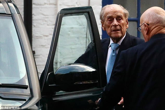 Prince Philip gets into a car as he leaves King Edward VII Hospital in London during a previous visit in December 2019. He will stay there for a few more days this week