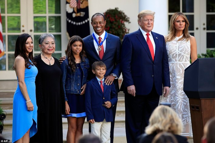 Woods is pictured alongside girlfriend Erica (far left), motherKultida (second left), daughter Sam and son Charlie, President Donald Trump and First Lady Melania (right) at the White House following his historic 15th Masters win in 2019